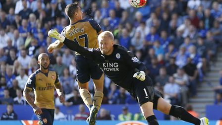Arsenal's Alexis Sanchez heads his second goal at Leicester to make it 3-1