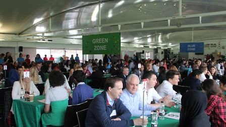 London business volunteers and local schoolchildren discuss careers at a mass speed networking event