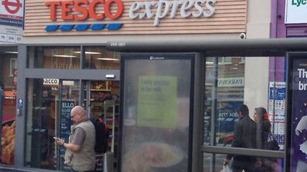 The men are thought to work in this Tesco Express branch in Preston Road