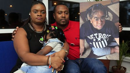 Pat and Norris Martin with their daughter Tashana-Rae, five, and a phot of their late son TJ, six (
