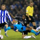 Arsenal's Glen Kamara (centre) in action during the Capital One Cup tie at Sheffield Wednesday