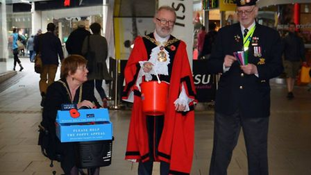 Mayor of Islington Cllr Richard Greening helps Islington veterans sell poppies in Angel, Islington