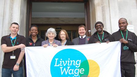 Council leaders and staff marking Living Wage awareness week at the town hall
