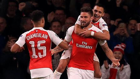 Arsenal's Olivier Giroud celebrates scoring his side's first goal against Bayern Munich with Alex Ox
