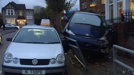 Passers-by captured the moment a car carrying a young passenger smashed into a wall in Cobbold Road