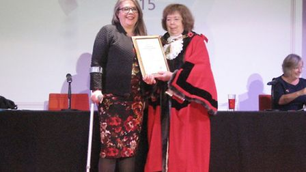 Sally Long, from Friends of Cricklewood Library, accepting a Community Champion Award from Cllr Lesl
