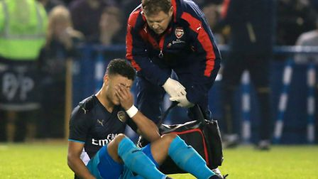 Arsenal's Alex Oxlade-Chamberlain was injured after just two minutes in the Capital One Cup tie at S