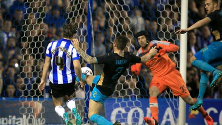Sam Hutchinson beats Arsenal's Mathieu Debuchy to the ball and fires past Petr Cech to score Sheffie