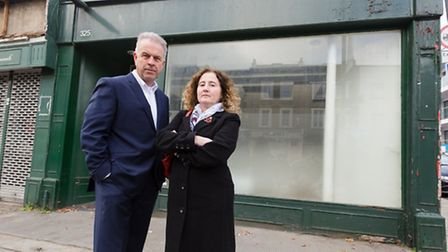 Cllrs Convery and O'Halloran outside the empty unit Paddy Power is seeking permission for