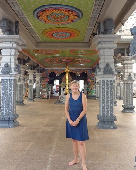 Rosemary Brown visits a temple in Singapore's Little India