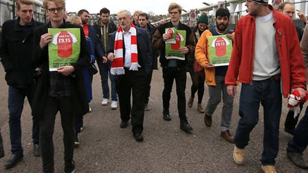 Mr Corbyn with Gunners fans outside Emirates Stadium on Sunday. Picture: John Walton/PA Wire