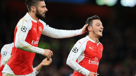 Arsenal's Mesut Ozil (right) celebrates with Olivier Giroud after scoring his side's first goal agai