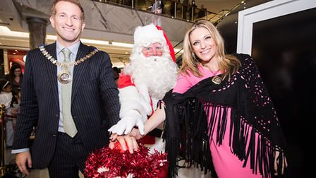 Mayor of Barnet Cllr Mark Shooter, his wife Michelle and Santa Claus switch on the Christmas lights
