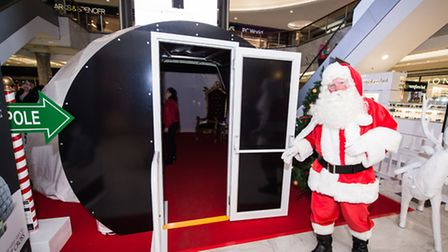 Santa Claus outside the immersive interactive grotto in Brent Cross