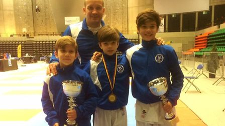 Left to right: Luca, Liam and Luan Veras with their medals at the Belgium Open Kumite Championships.