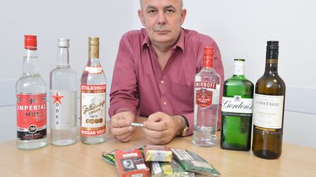 Islington trading standards officer Doug Love with bottles of counterfeit alcohol