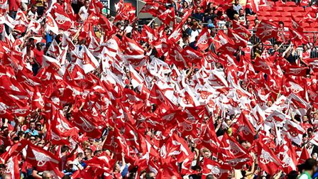 Arsenal flags being waved by supporters during the FA Community Shield at Wembley Stadium, London. P