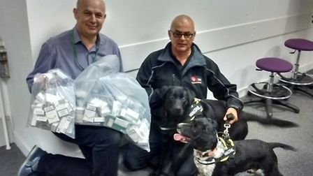 Islington trading standards officers with detection dogs Alfie and Indy
