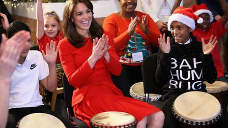 Catherine, Duchess of Cambridge takes part in some drumming 'music therapy' as she attends the Anna