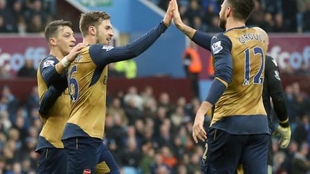 Arsenal's Aaron Ramsey (centre) celebrates scoring his side's second goal at Aston Villa with team-m