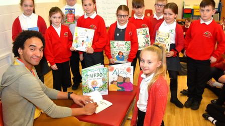 Poet and author Joseph Coelho signing his books for pupils at Gunton Primary Academy. Pictures: Mick