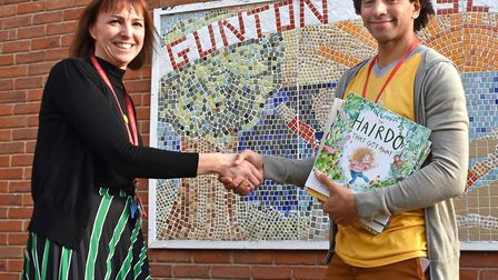 Poet and author Joseph Coelho at Gunton Primary Academy with LKS2 leader Mrs Smith. Pictures: Mick H