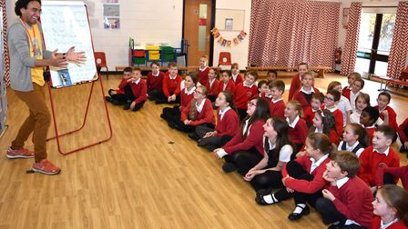 Poet and author Joseph Coelho with some of the pupils at Gunton Primary Academy. Pictures: Mick Howe