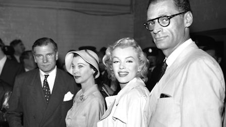 Sir Laurence and Lady Olivier at London Airport to meet Marilyn Monroe and her husband playwright Ar