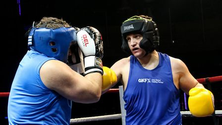 David Lindsay, pictured in yellow gloves, at the white collar boxing match in the 02 Arena's Indigo
