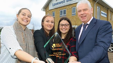 Staff from Lovewell Blakes Lowestoft office with the Employer of the Year trophy they won at the Low