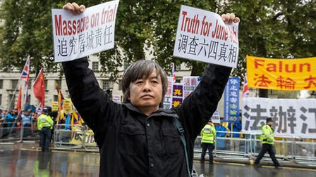 Dr Shao Jiang protesting the day before his arrest outside Mansion House in October. Picture: Guy Co