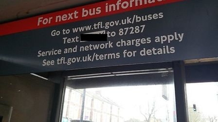 """A risqu� five digit passcode on a bus stop sign in Kensal Rise has left passengers """"confused"""". (Pic"""