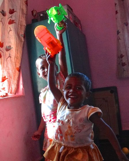 Children at the ASTHA orphanage in Koraput, Orissa, playing with toys bought locally