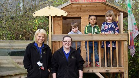 """Treetops Children Centre Rated """"Good"""" Liz Boffey, manager, Akira Morgan, deputy manager with pupils"""