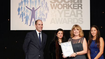 Tracy Caton, second right, receives the award from sponsors. Picture: Matt Grayson/Felicity Crawshaw