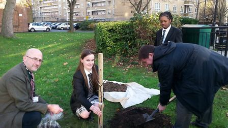 Teacher Justin Willson, with Erjola Noka, Cllr Andy Hull and year 8 student from the gardening club
