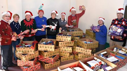 Lowestoft Lions club members and wives with some of the hampers ready for delivery to deserving home