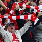 Arsenal fans show their colours and support in the stands. Picture: Nick Potts/PA