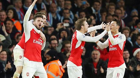 Arsenal players celebrate after Olivier Giroud makes it 2-0 against Manchester City