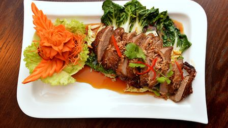Bangkok Lounge's Ped Makarm, stirfried roasted duck on a bed of vegetables with tamarind sauce. Pict