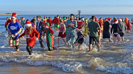 It was a quick dip in and out for many in Lowestoft on Christmas Day Picture: Mick Howes