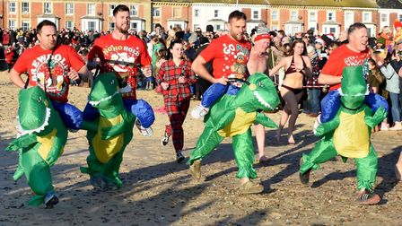 Christmas diip organisers donned dinosaur costumes at Lowestoft Picture: Mick Howes
