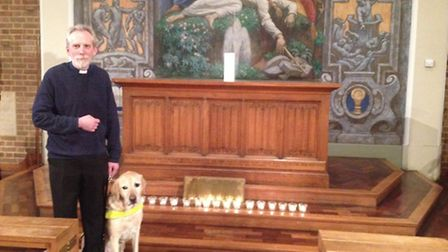 Rev John Beauchamp, pictured with guide dog Nelson, led yesterday's service at St Stephen's Church,