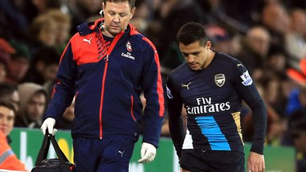 Arsenal's Alexis Sanchez (right) leaves the field injured against Norwich City.