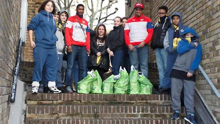 Shawdon Smith (fourth from right) delivering gifts to residents on the Elthorne Estate with local yo