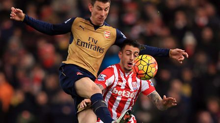 Arsenal's Laurent Koscielny (left) and Stoke City's Joselu battle for the ball
