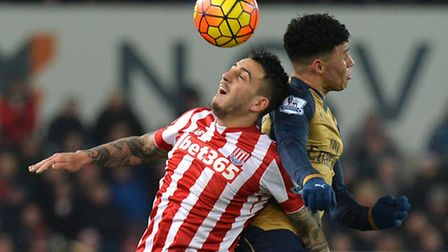 Stoke City's Joselu (left) and Arsenal's Alex Oxlade-Chamberlain battle for the ball during Sunday's