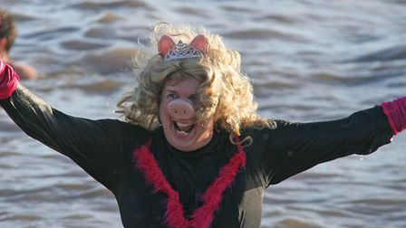 Southwold Christmas Day Swim 2013: Southwold community matron Cathy Ryan took a dip dressed as Miss