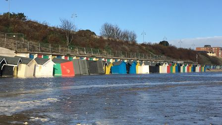 The huts after the spring tide surged onto Pakefield Beach. photo: James Carr.