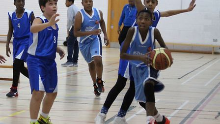 Access 2 Sport's Manie Joses (with ball) led the Under-12s to victory over Barnet East Giants in the